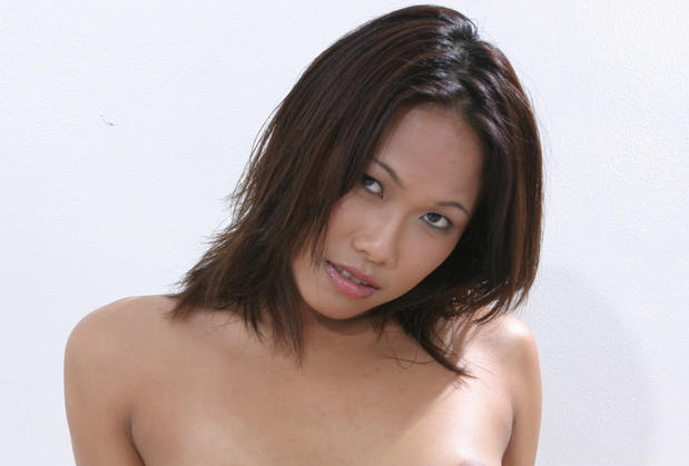 Cute Asian with small tits spread legged